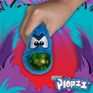 Squeeze your ORB Odditeez™ Ploppz™ to unleash a bubble of sparkly goo.